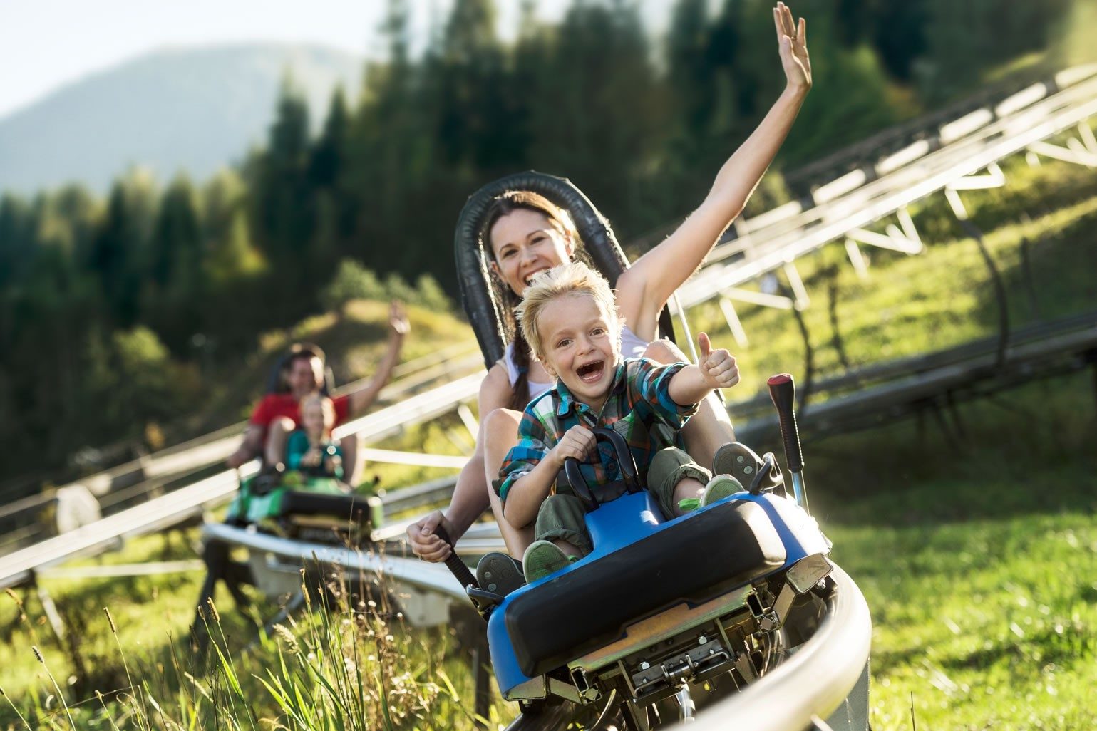 Family summer tobogganing on the Lucky Flitzer in Flachau